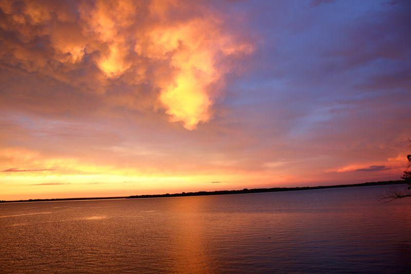 Fluffy clouds sunset foss lake