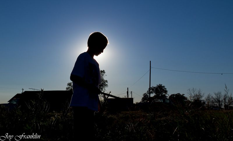 Justin the Okra Picker in the shadows (1 of 1)
