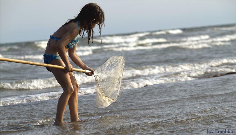 Ali fishing on beach