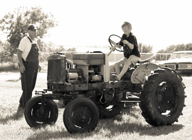 Papa and Justin and the tractor on the farm (1 of 1)