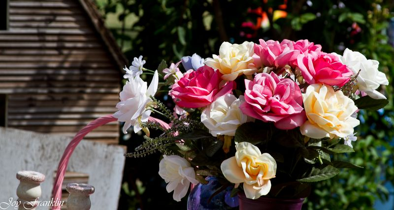 Fake flowers on a garage sale-4172