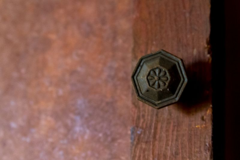 Old knob on a closet door in an abandoned house-1325