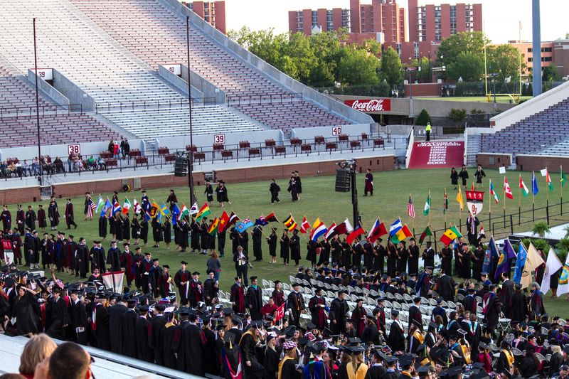 Commencement walking on the field-2298