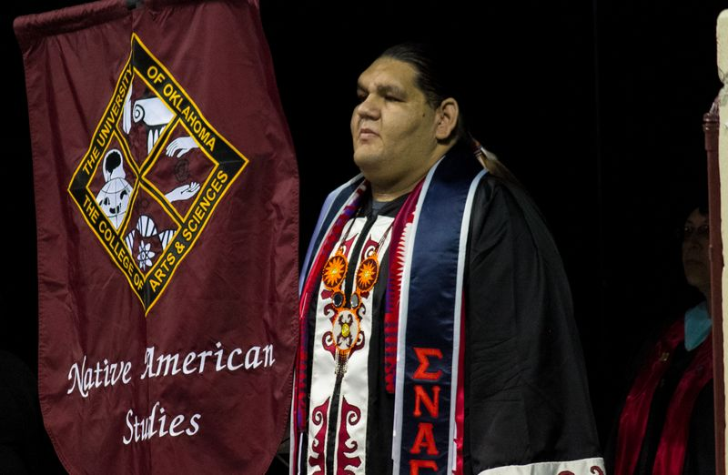 Corey still carrying flag at convocation-2498