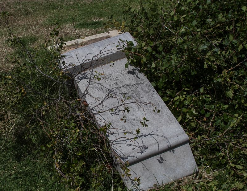 Vandalized graves at Oakwood Cemetery-1311