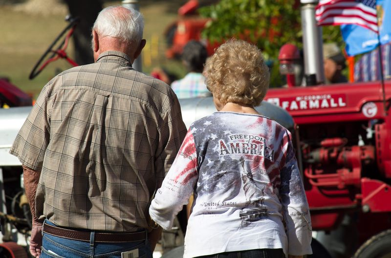 Elderly Couple Holding Hands at Murray County Antique tractor show in Sulphur-3804