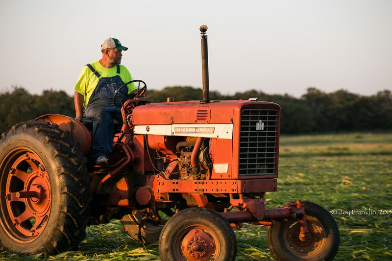 Steve Cutting Hay on the Farm -1-2